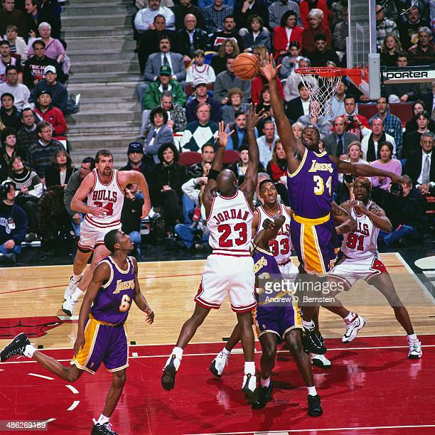 Michael Jordan of the Chicago Bulls shoots against Shaquille O'Neal of the Los Angeles Lakers on December 17 1996 at the United Center in Chicago...