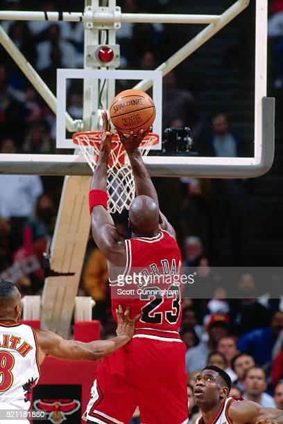 Michael Jordan of the Chicago Bulls shoots against the Atlanta Hawks at The Omni Arena on February 14 1997 in Atlanta Georgia NOTE TO USER User...