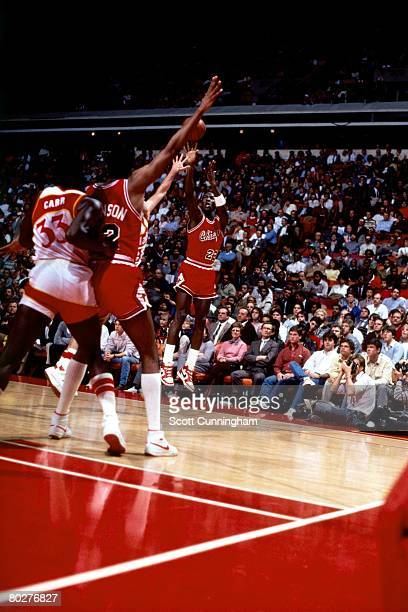 Michael Jordan of the Chicago Bulls shoots against the Atlanta Hawks during his rookie season in 1984 in Chicago Illinois NOTE TO USER User expressly...