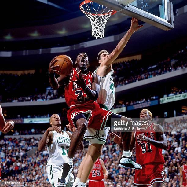 Michael Jordan of the Chicago Bulls shoots against the Boston Celtics circa 1998 at The Boston Garden in Boston, Massachusettes. NOTE TO USER: User...