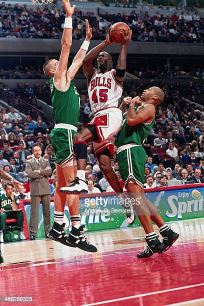 Michael Jordan of the Chicago Bulls shoots against the Boston Celtics circa 1995 at the United Stadium in Chicago Illinois NOTE TO USER User...