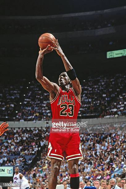 Michael Jordan of the Chicago Bulls shoots against the Cleveland Cavaliers circa 1991 at the Richfield Coliseum in Richfield, Ohio. NOTE TO USER:...