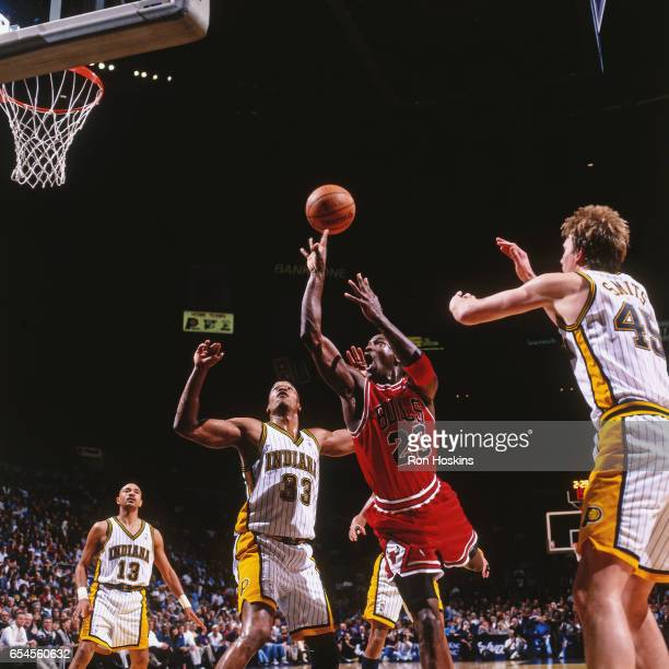 Michael Jordan of the Chicago Bulls shoots against the Indiana Pacers on November 28 1997 at Market Square Arena in Indianapolis Indiana NOTE TO USER...