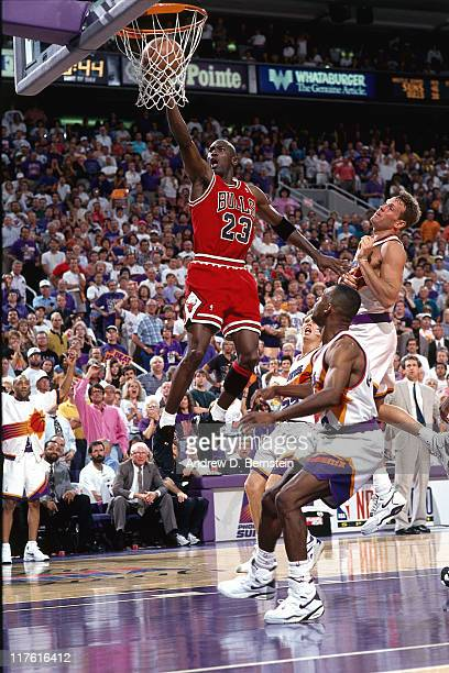 Michael Jordan of the Chicago Bulls shoots against the Phoenix Suns circa 1993 at The US Airways Center in Phoenix Arizona NOTE TO USER User...