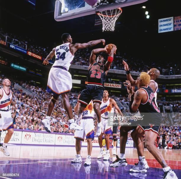 Michael Jordan of the Chicago Bulls shoots against the Phoenix Suns on November 20 1997 at America West Arena in Phoenix Arizona NOTE TO USER User...