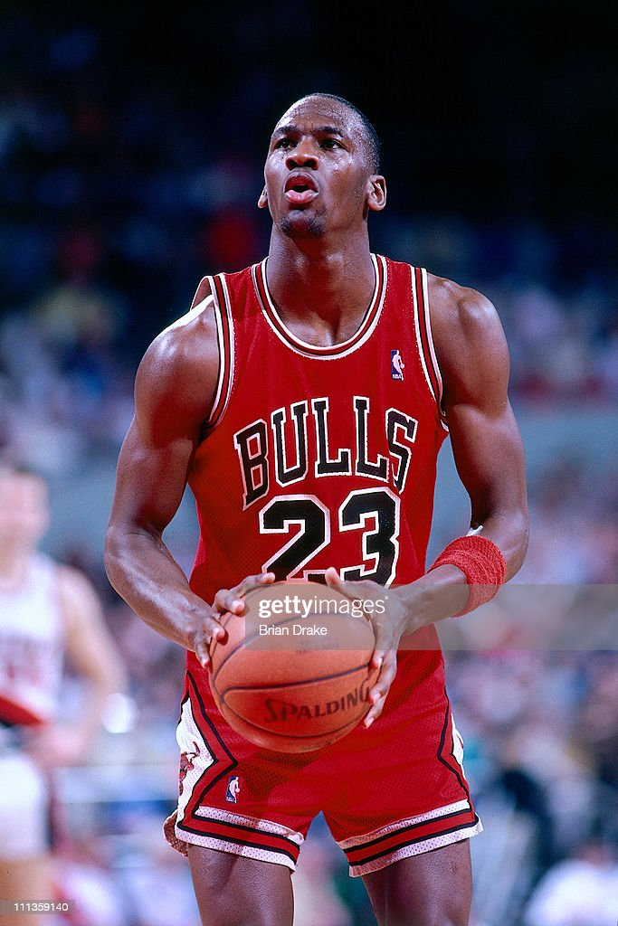 Michael Jordan of the Chicago Bulls shoots against the