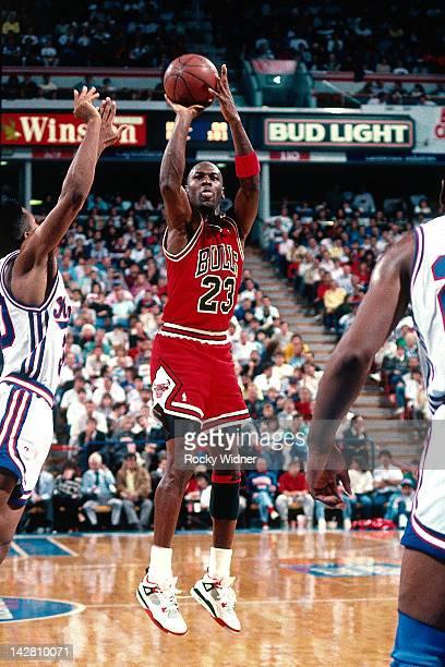 Michael Jordan of the Chicago Bulls shoots against the Sacramento Kings during a game played on November 14 1989 at the Arco Arena in Sacramento...