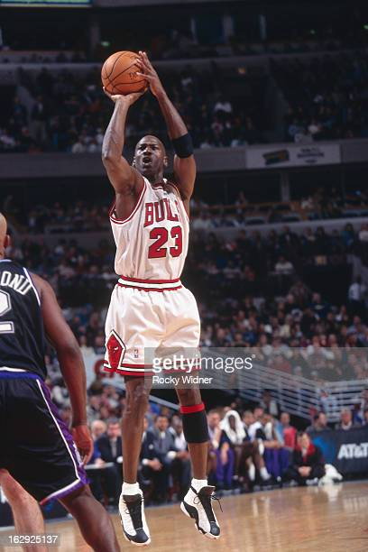 Michael Jordan of the Chicago Bulls shoots against the Sacramento Kings during a game played on February 28 1998 at the United Center in Chicago...