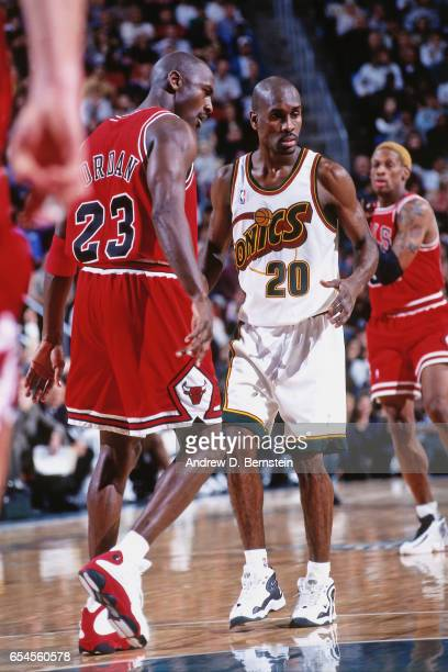 Michael Jordan of the Chicago Bulls shoots against the Seattle Supersonics on November 25 1997 at Key Arena in Seattle Washington NOTE TO USER User...