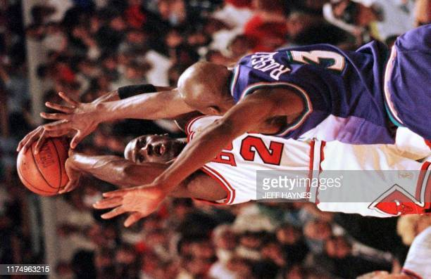 Michael Jordan of the Chicago Bulls shoots over Bryon Russell of the Utah Jazz 13 June during the first half of game six of the 1997 NBA Finals at...