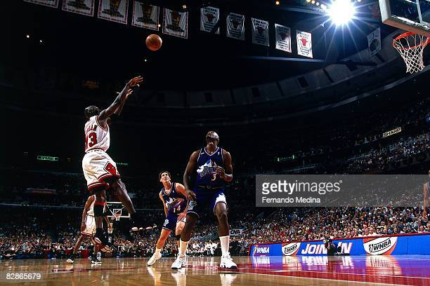 Michael Jordan of the Chicago Bulls shoots over Byron Russell of the Utah Jazz in Game Five of the 1998 NBA Finals at the United Center on June 12...