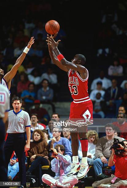Michael Jordan of the Chicago Bulls shoots over Jeff Malone of the Washington Bullets during an NBA basketball game circa 1988 at the Capital Centre...