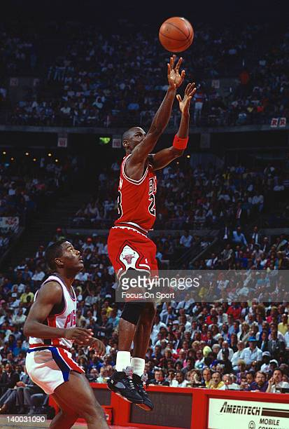 Michael Jordan of the Chicago Bulls shoots over Joe Dumars of the Detroit Pistons during an NBA basketball game circa 1989 at The Palace at Auburn...