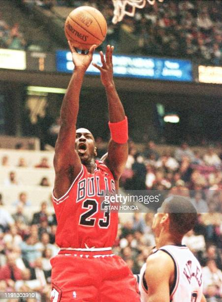 Michael Jordan of the Chicago Bulls shoots over Kerry Kittles of the New Jersey Nets in the first quarter of first round playoff game 29 April at...
