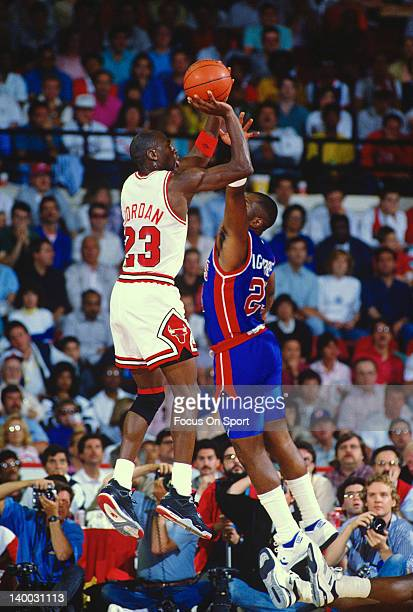 Michael Jordan of the Chicago Bulls shoots over Mark Aguirre of the Detroit Pistons during an NBA basketball game circa 1989 at the Chicago Stadium...