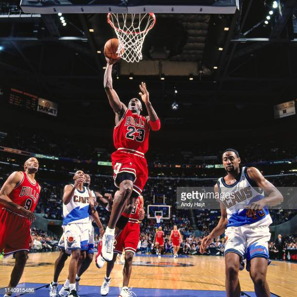 Michael Jordan of the Chicago Bulls shoots the ball against the on April 9 1998 at the Gund Arena in Cleveland Ohio NOTE TO USER User expressly...