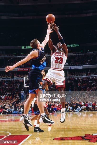 Michael Jordan of the Chicago Bulls shoots the ball against the Cleveland Cavaliers on December 28 1996 at the United Center in Chicago Illinois NOTE...