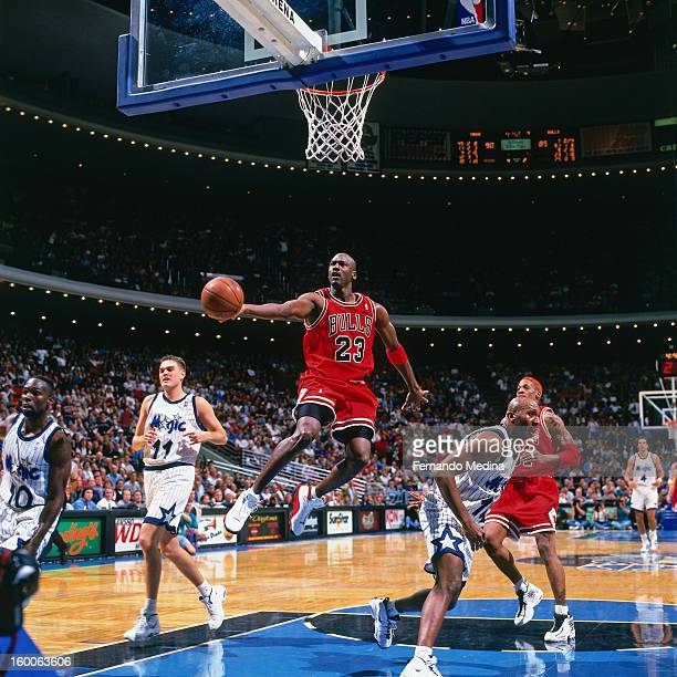 Michael Jordan of the Chicago Bulls shoots the ball against the Orlando Magic on December 10 1997 at the Orlando Arena in Orlando Florida NOTE TO...