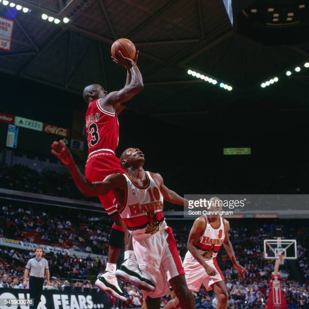 Michael Jordan of the Chicago Bulls shoots the ball against the Atlanta Hawks on February 22 1996 at the Omni Coliseum in Atlanta Georgia NOTE TO...