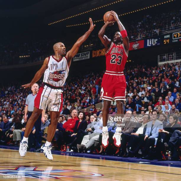 Michael Jordan of the Chicago Bulls shoots the ball during the game against Mario Elie of the Houston Rockets on January 19 1997 at The Summit in...