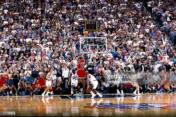 Michael Jordan of the Chicago Bulls shoots the game winner over Byron Russell of the Utah Jazz during Game six of the 1998 NBA Finals that gave the...
