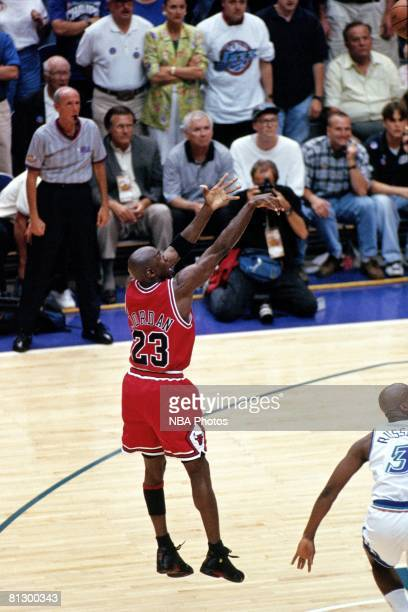 Michael Jordan of the Chicago Bulls shoots the game winning jumpshot against the Utah Jazz during game six of the 1998 NBA Finals at the Delta Center...