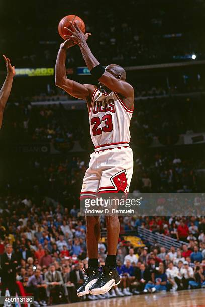 Michael Jordan of the Chicago Bulls shoots the game winning shot against the Utah Jazz during Game One of the 1997 NBA Finals on June 1 1997 at the...