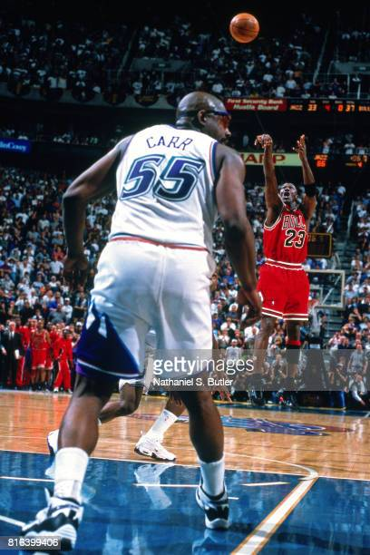 Michael Jordan of the Chicago Bulls shoots the game winning shot against the Utah Jazz during Game Six of the 1998 NBA Finals played on June 14 1998...
