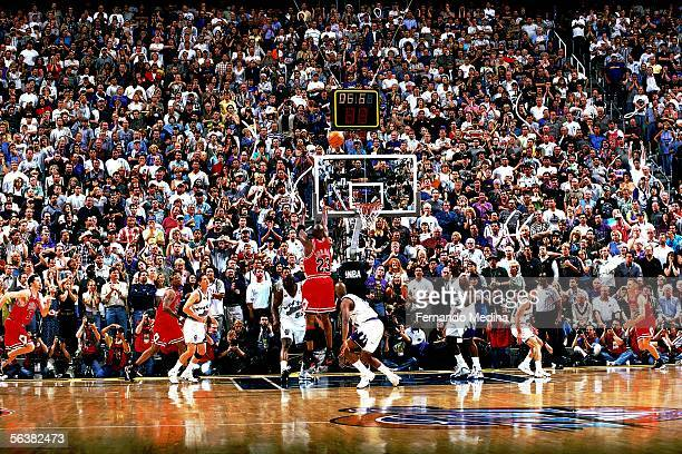 Michael Jordan of the Chicago Bulls shoots the game-winning jumpshot over Byron Russell of the Utah Jazz during Game Six of the 1998 NBA Finals on...
