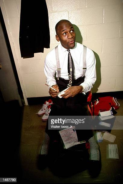 Michael Jordan of the Chicago Bulls signs autographs in 1990 after playing in an NBA game NOTE TO USER User expressly acknowledges and agrees that by...