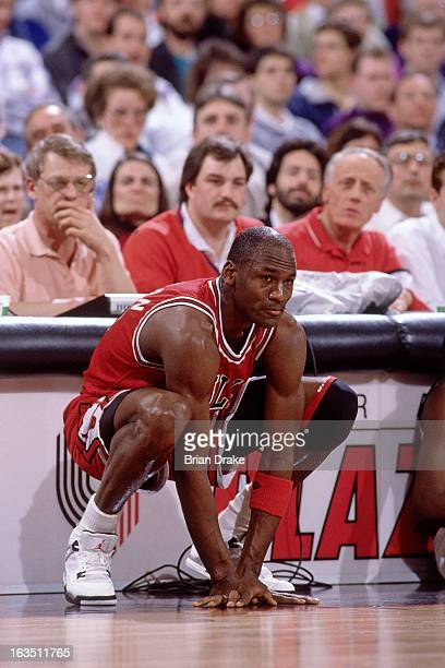 Michael Jordan of the Chicago Bulls sits at the scorers table against the Portland Trail Blazers during a game played circa 1989 at the Veterans...