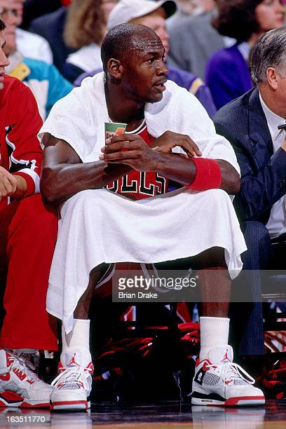 Michael Jordan of the Chicago Bulls sits on the bench against the Portland Trail Blazers during a game played circa 1989 at the Veterans Memorial...