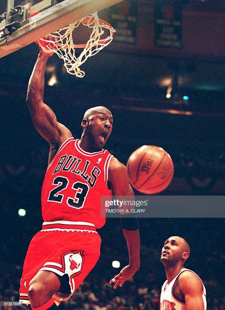 Michael Jordan of the Chicago Bulls slam dunks the ball