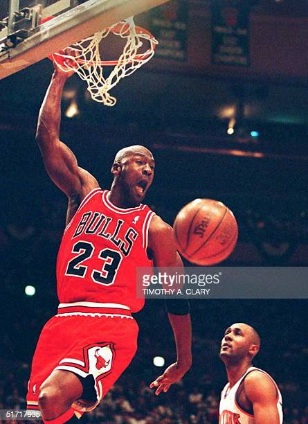 Michael Jordan of the Chicago Bulls slam dunks the ball during game four of the NBA Eastern Conference semifinals against the New York Knicks 12 May...