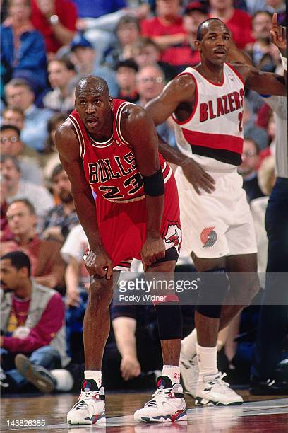 Michael Jordan of the Chicago Bulls stands against Clyde Drexler of the Portland Trailblazers on February 7 1993 at Veterans Memorial Coliseum in...