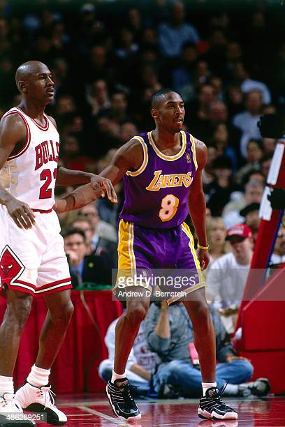Michael Jordan of the Chicago Bulls stands against Kobe Bryant of the Los Angeles Lakers on December 17 1996 at the United Center in Chicago Illinois...