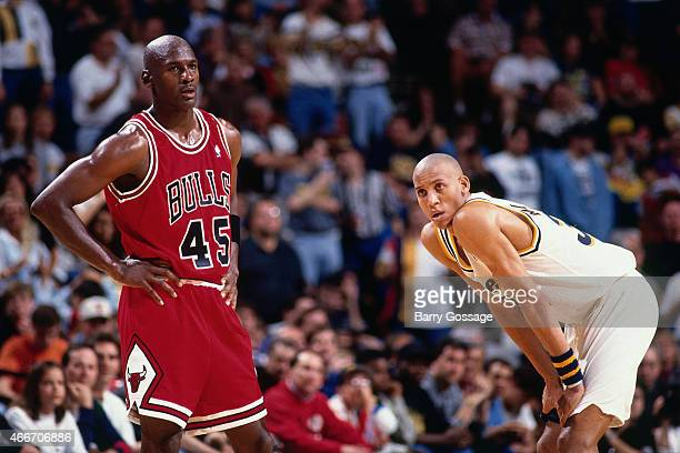 Michael Jordan of the Chicago Bulls stands against Reggie Miller of the Indiana Pacers on March 19 1995 at Market Square Arena in Indianapolis...