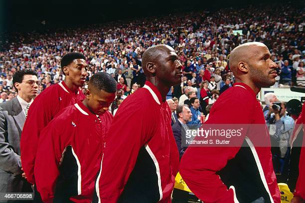 Michael Jordan of the Chicago Bulls stands for the anthem against the Indiana Pacers on March 19 1995 at Market Square Arena in Indianapolis Indiana...