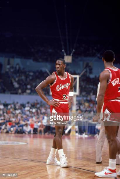 Michael Jordan of the Chicago Bulls stands on the court during a 1984 season game against the Los Angeles Clippers at the Sports Arena in Los Angeles...