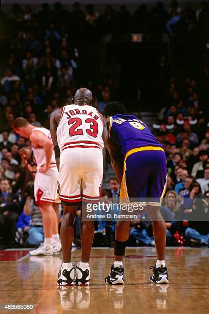 Michael Jordan of the Chicago Bulls stands on the court during a game against Kobe Bryant of the Los Angeles Lakers on December 17 1997 at Chicago...