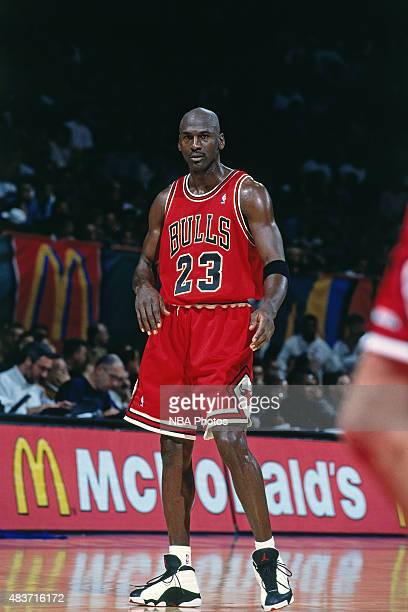 Michael Jordan of the Chicago Bulls stands on the court during a game during the 1997 McDonald's Championship circa 1997 at the Palais Omnisports de...