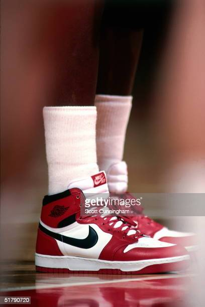 Michael Jordan of the Chicago Bulls stands wearing Nike sneakers against the Atlanta Hawks during an NBA game circa 1986 at the Omni in Atlanta...