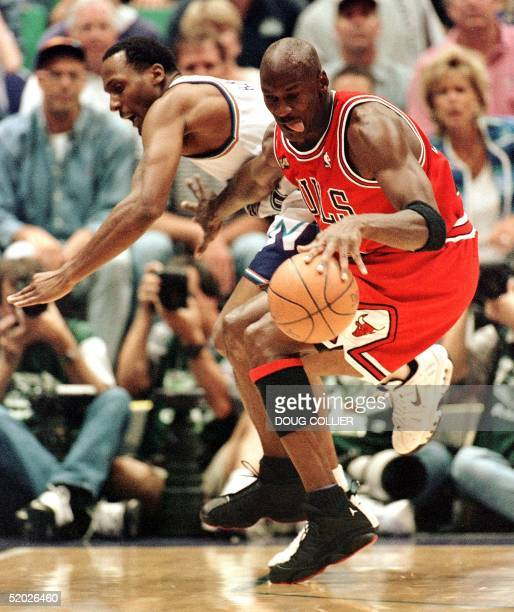 Michael Jordan of the Chicago Bulls steals the ball from Shandon Anderson of the Utah Jazz 05 June during first half action of game two of the NBA...