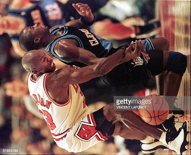 Michael Jordan of the Chicago Bulls steals the basketball from Cleveland Cavaliers guard Mitchell Butler during the first quarter of the 15 November...