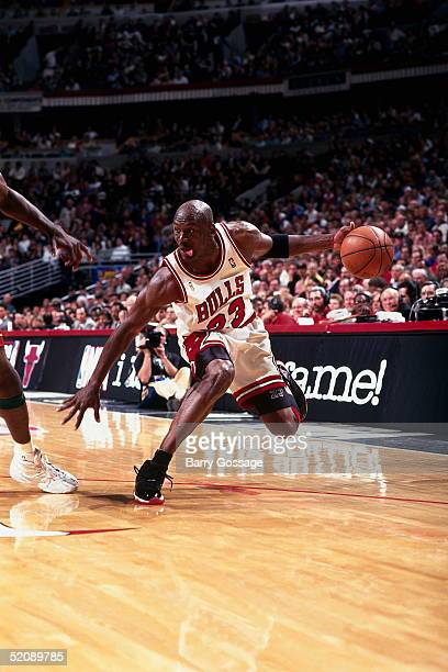 Michael Jordan of the Chicago Bulls stops his drive short against the Seattle Sonics during Game two of the 1996 NBA Finals at United Center on June...