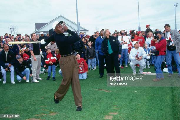 Michael Jordan of the Chicago Bulls swings a baseball bat during the Michael Jordan Golf Opening on October 31 1995 in Aurora Illinois NOTE TO USER...