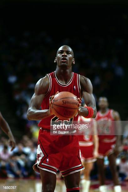 Michael Jordan of the Chicago Bulls takes a free throw during the 1990 NBA game against the Houston Rockets in Houston, Texas. NOTE TO USER: User...