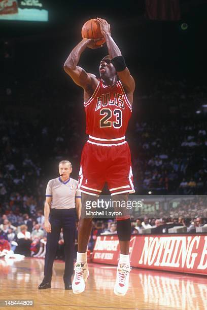 Michael Jordan of the Chicago Bulls takes a jump shot during a basketball game against the Washington Bullets at the Capitol Centre on December 14...