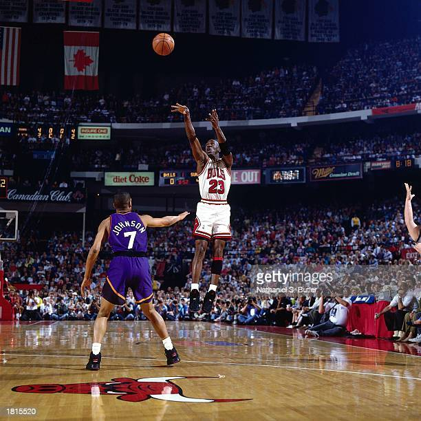 Michael Jordan of the Chicago Bulls takes a jumper against the Phoenix Suns during Game Five of the 1993 NBA Championship Finals at Chicago Stadium...