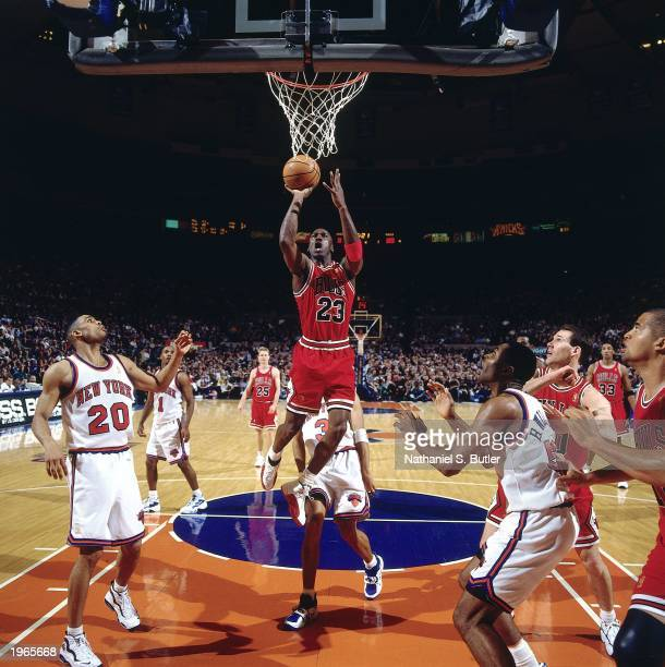 Michael Jordan of the Chicago Bulls takes a layup against the New York Knicks during the NBA game at Madison Square Garden on April 19 1997 in New...